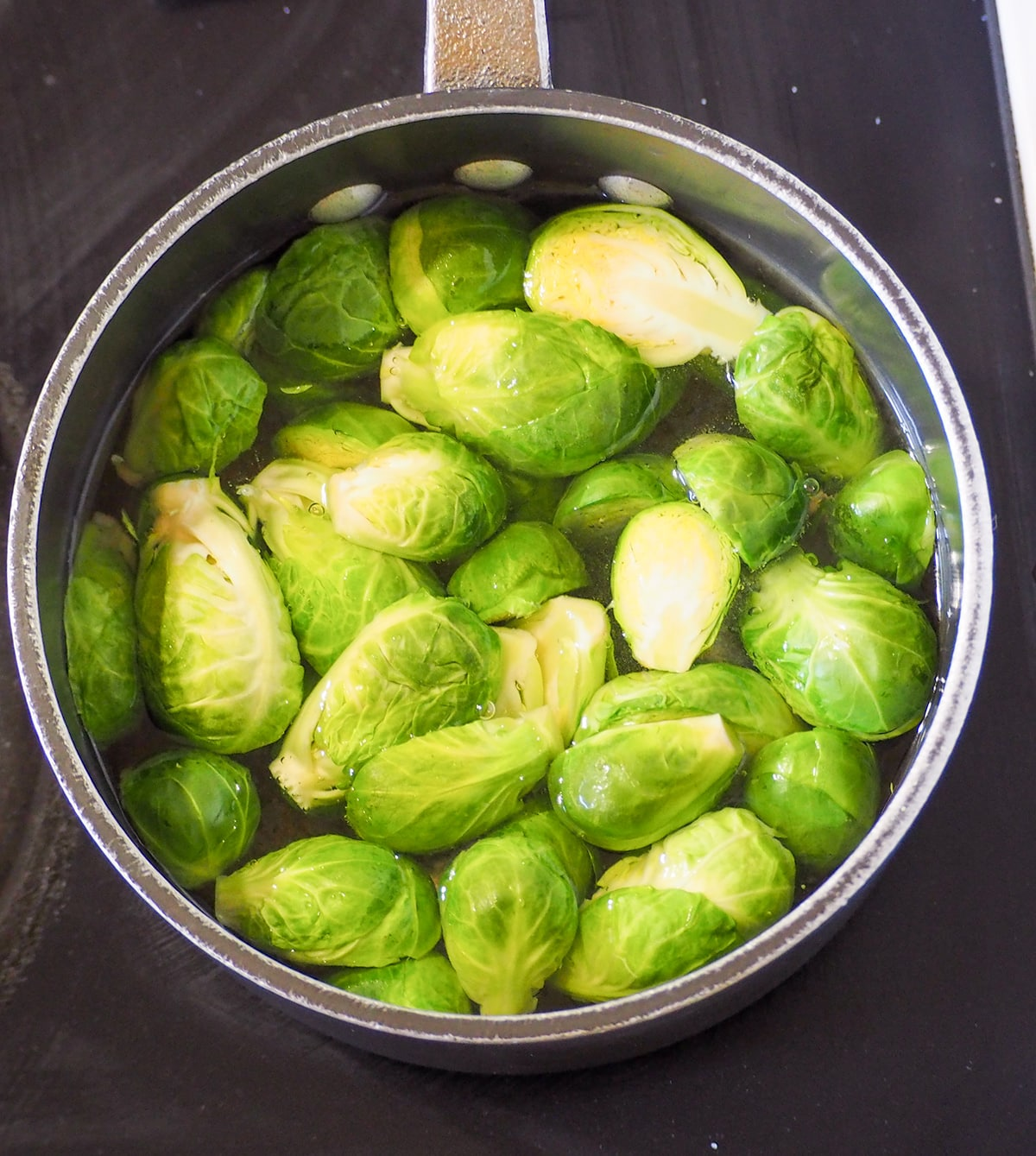 brussel sprouts in pot of water on stove