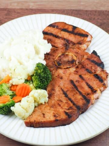 grilled ham steak dinner on plate