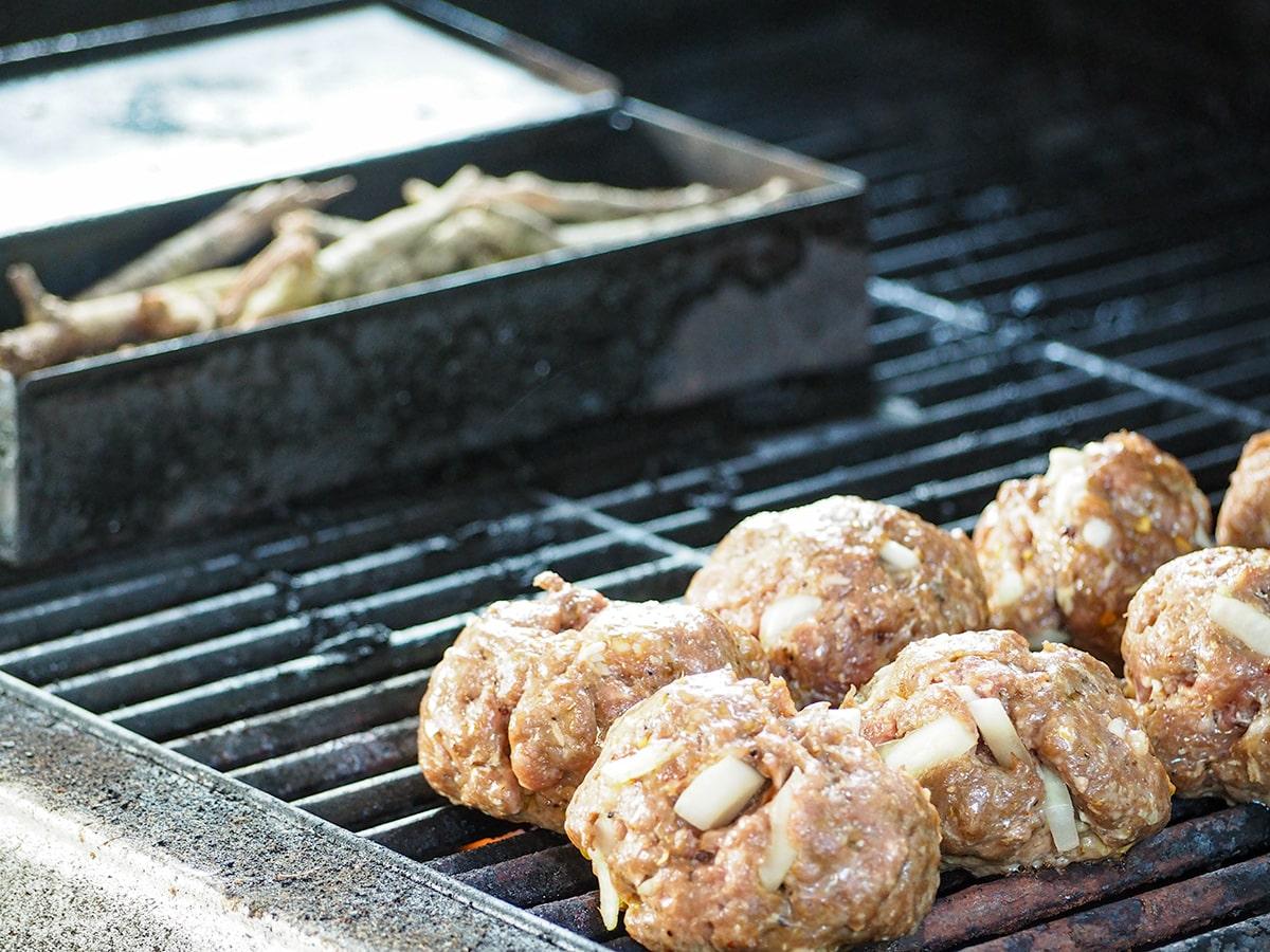 meatballs on bottom of grill on indirect heat next to smoke box