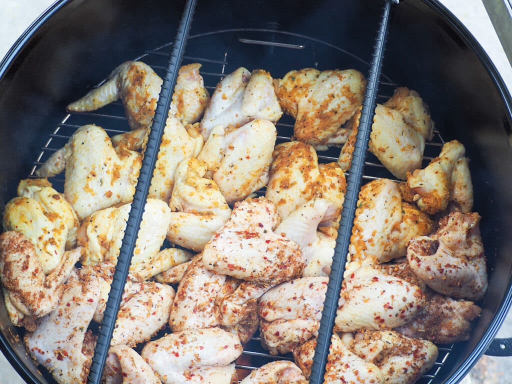 raw chicken wings on grill